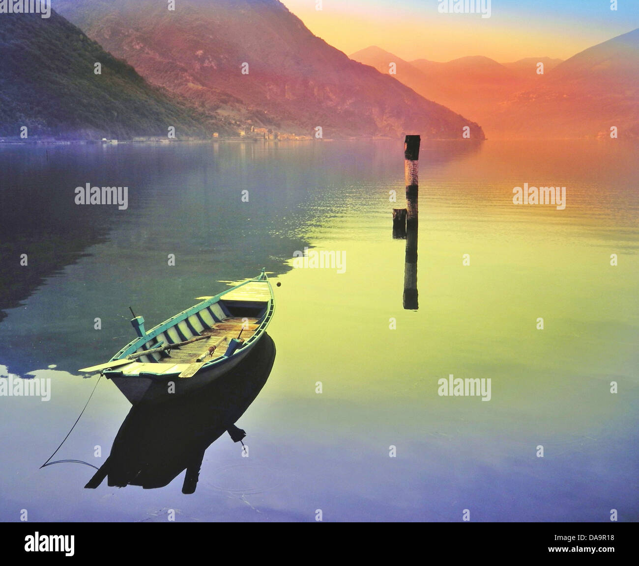 Italy, Iseo, lake, oar boat, small boat, mountains, reflection, light, alienated - Stock Image