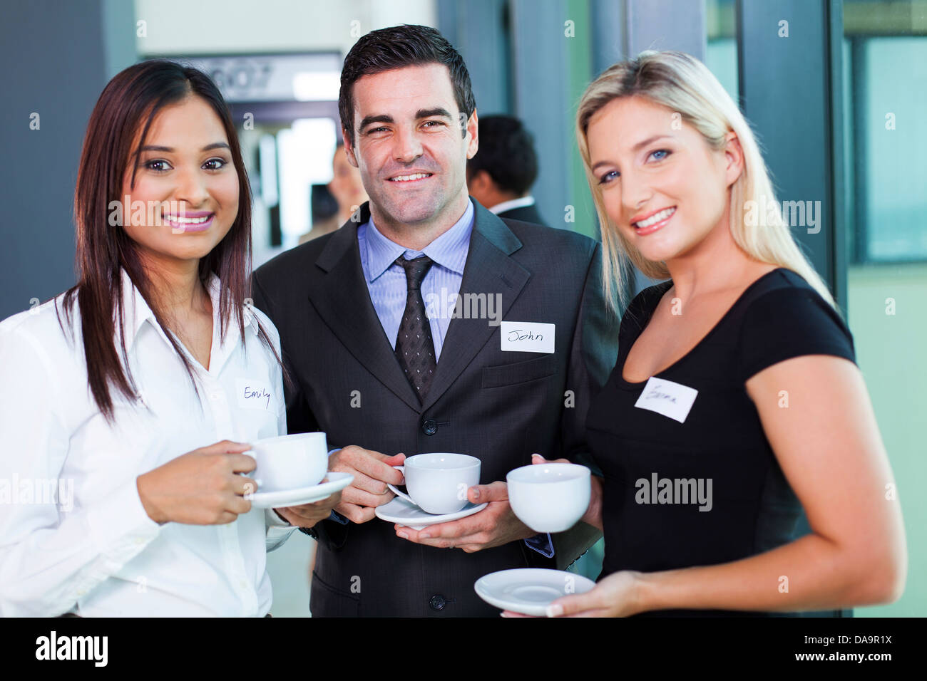 group of business people having coffee during business conference break - Stock Image