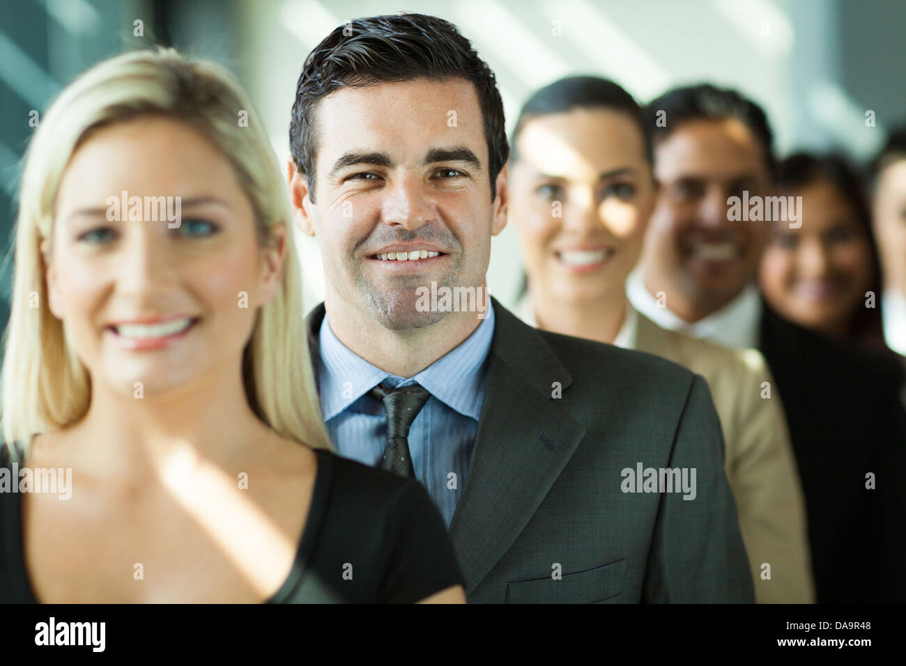 group of modern business people in a row - Stock Image