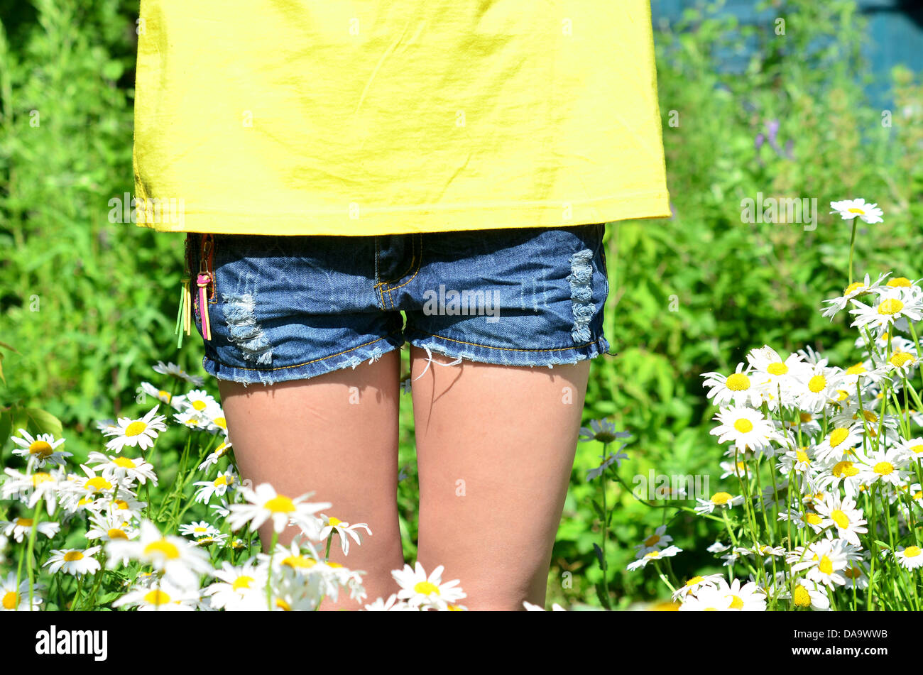 part of woman body against summer background - Stock Image