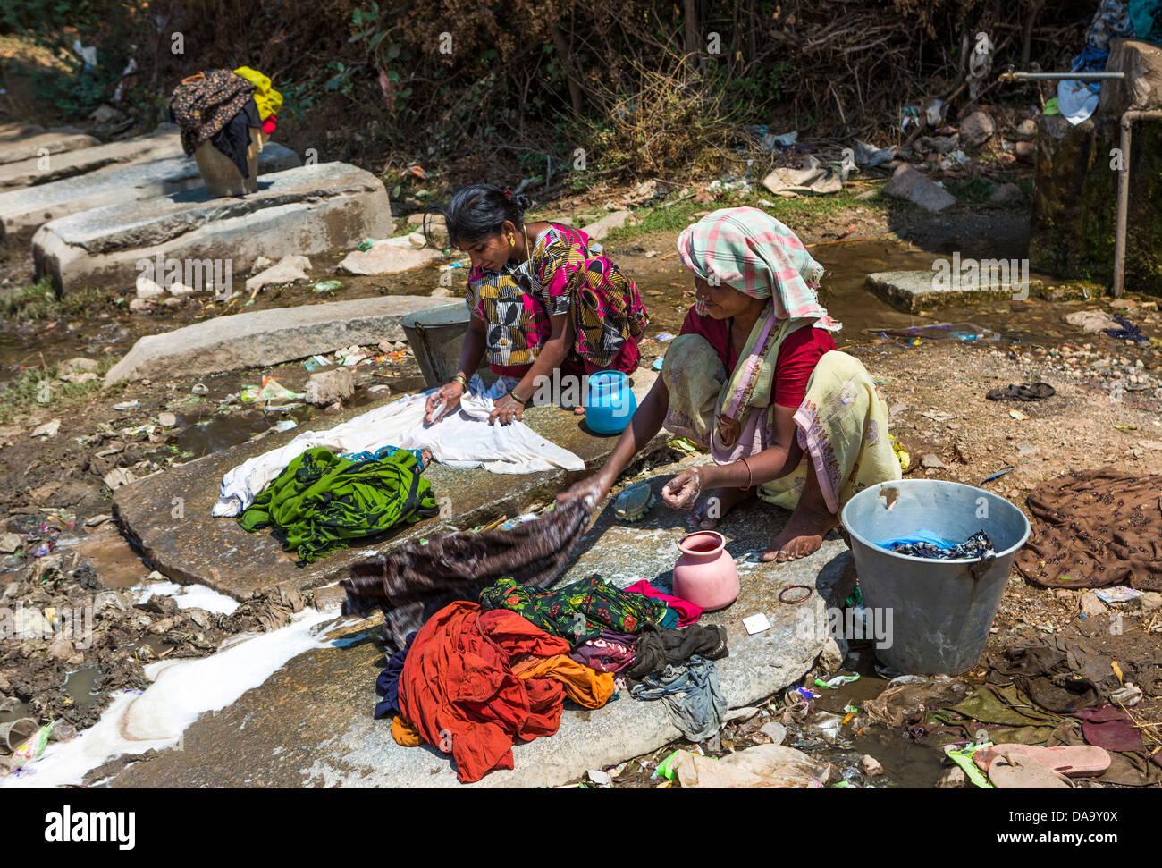 India, South India, Asia, primitive, colourful, hard, washing, women, working - Stock Image