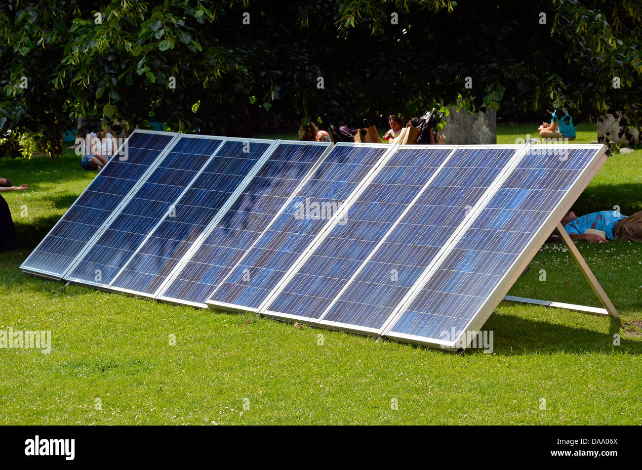 Portable solar panels (photovoltaic panels) powering outdoor PA systems during the Hat Fair , Cathedral Close, Winchester. - Stock Image