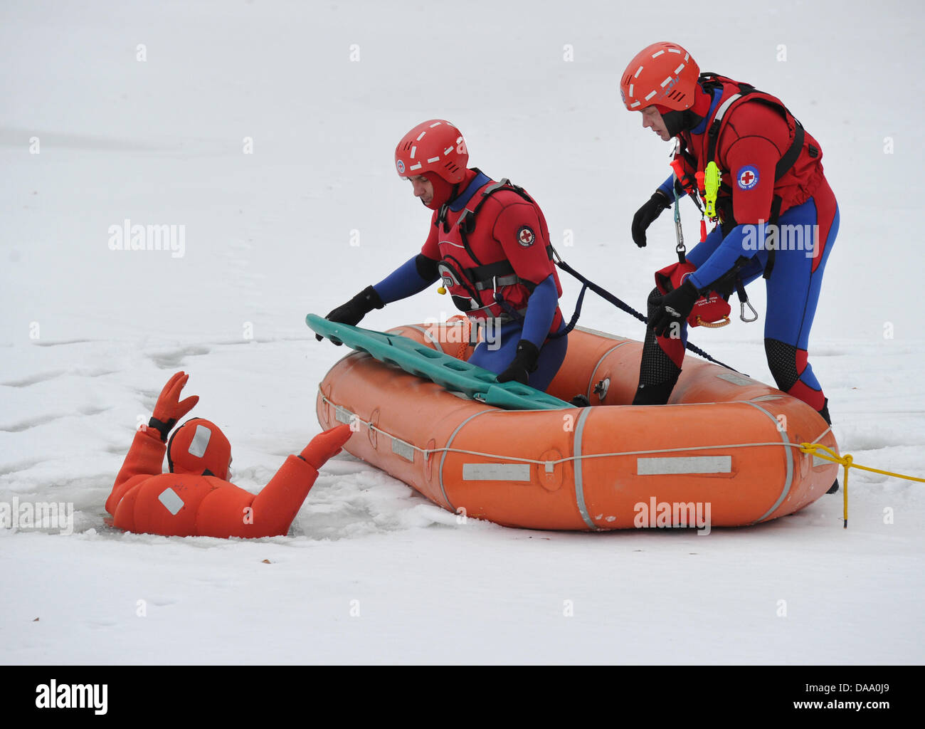 Members of the German Red Cross Water Rescue service perform a rescue exercise on the ice sheet of a lake in Muellrose, - Stock Image