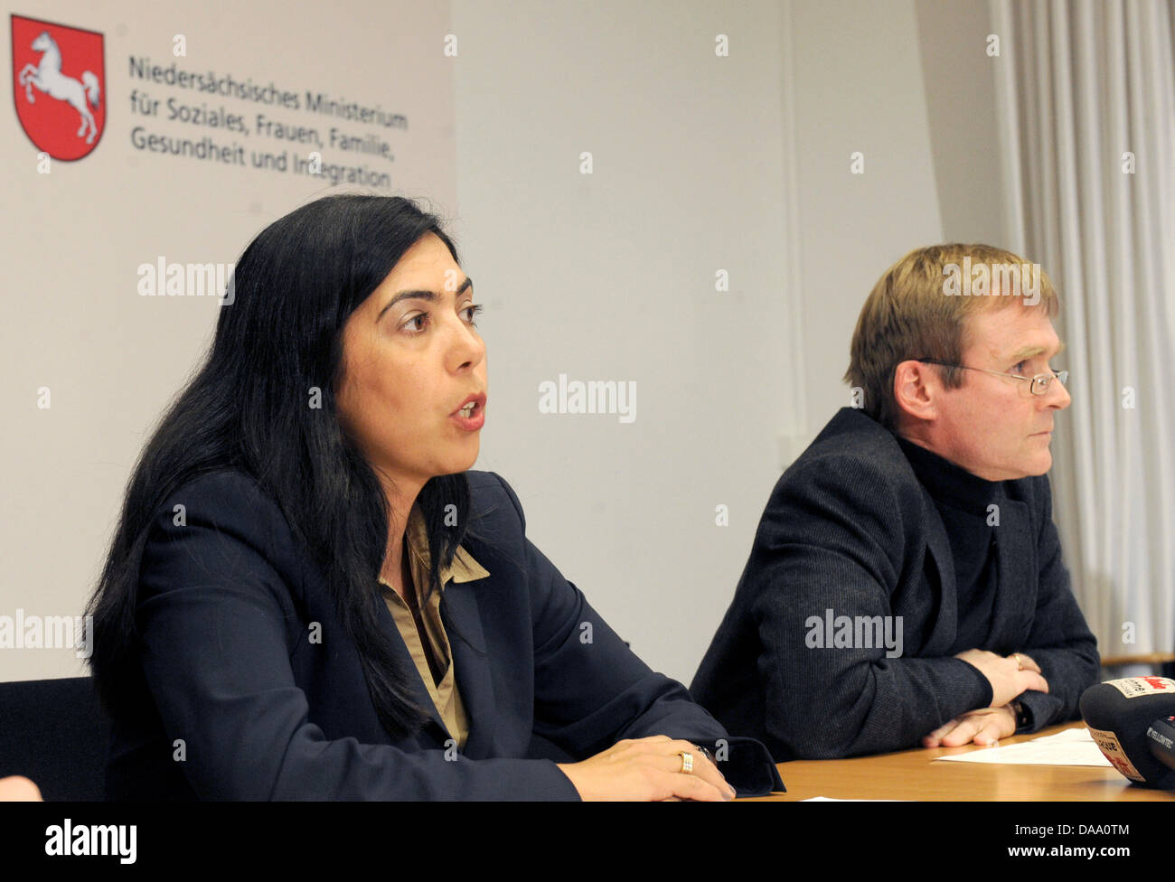 Lower Saxony's Minister of Health and Social Affairs, Aygul Ozkan (CDU) (L), and The director of department - Stock Image