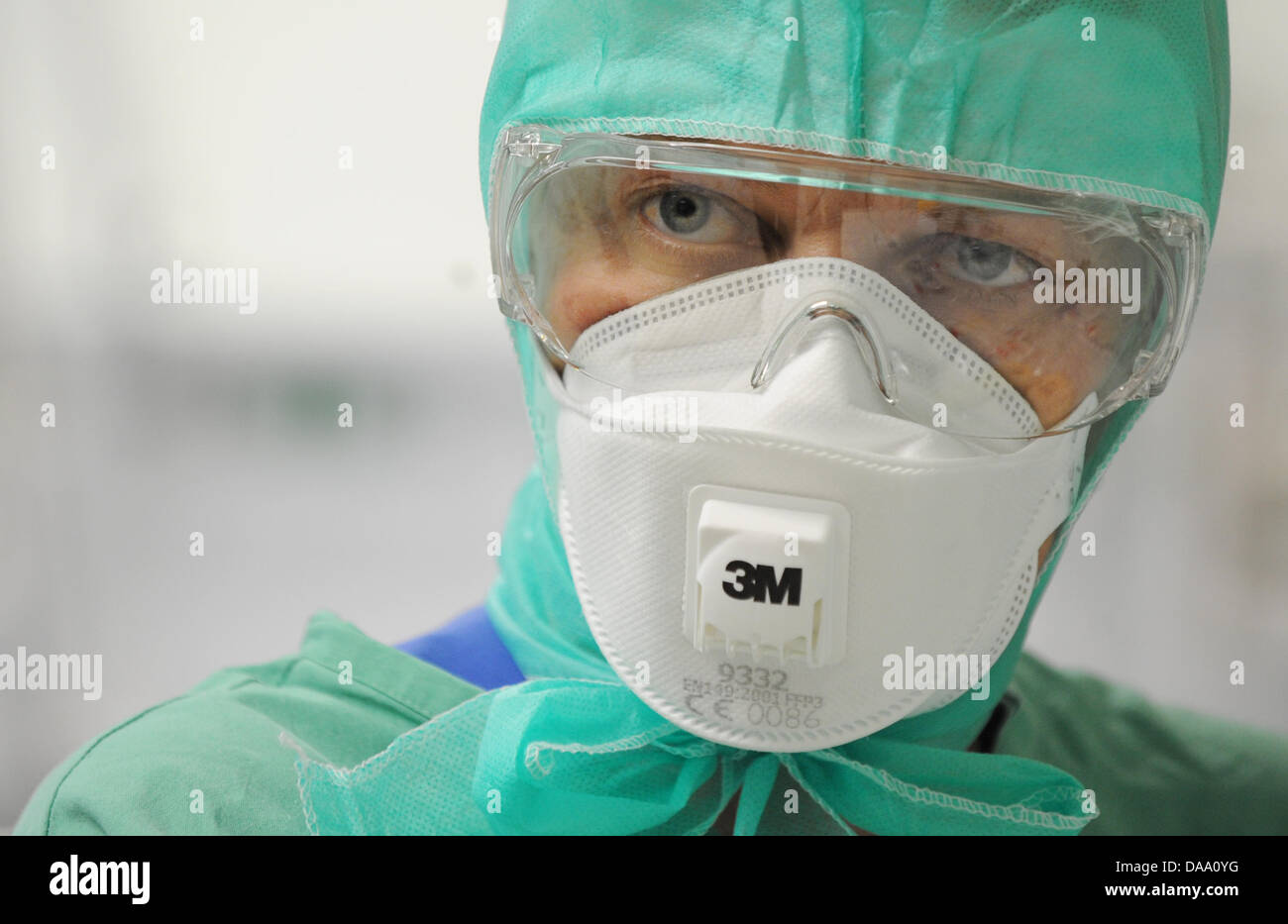 (dpa File) - A file picture, dated 30 April 2009, shows a nurse wearing protective clothing against infections in - Stock Image