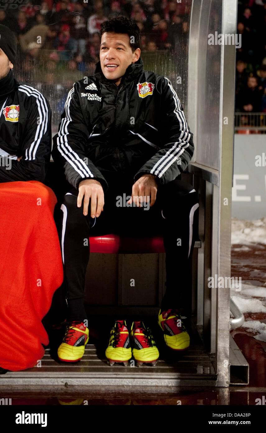 Leverkusen's Michael Ballack smiles on the bench during test match Rot-Weiss Oberhausen v Bayer 04 Leverkusen - Stock Image