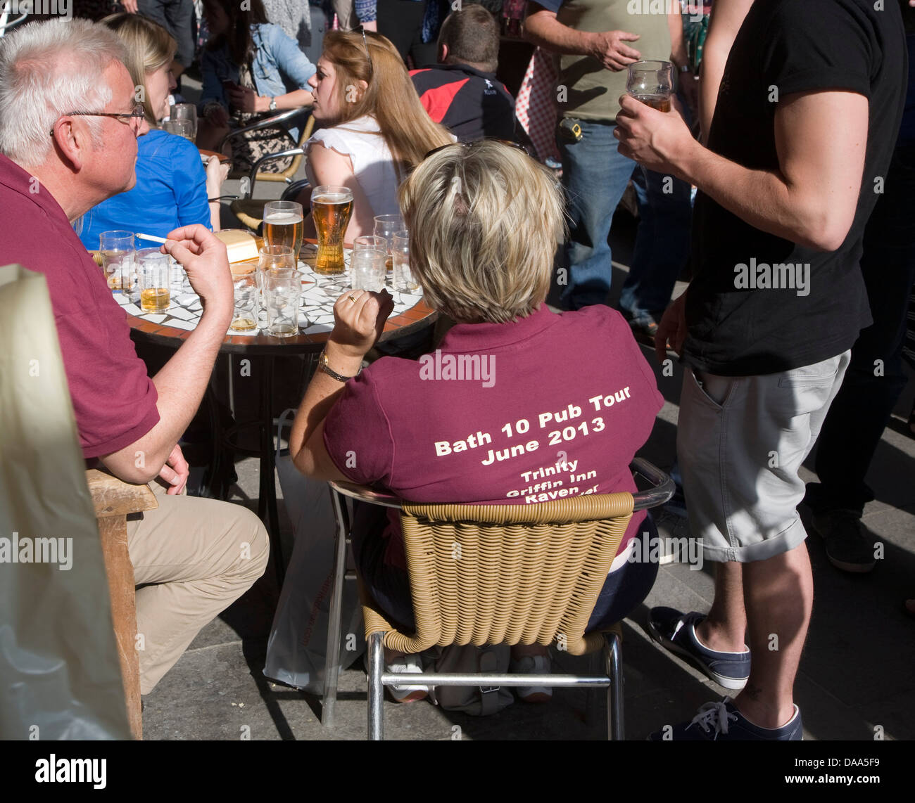 People on a pub crawl wearing t shirts outside the Couer de Lion pub in central Bath, Somerset, England - Stock Image