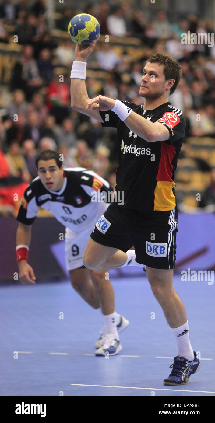 Michael Kraus (R) of Germany throws a seven-metres during the Men's Handball World Championship preliminary round Stock Photo