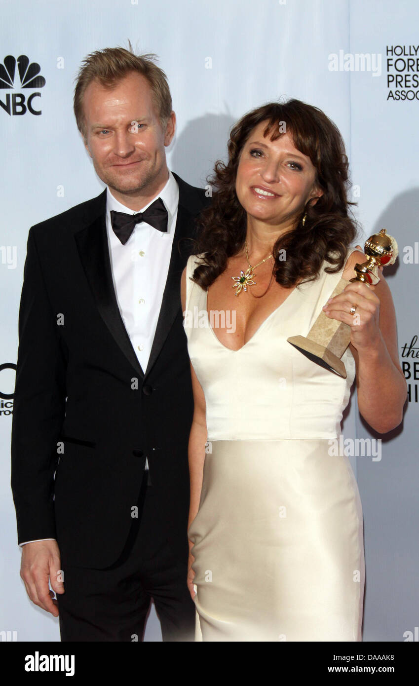 Danish director, writer and producer Susanne Bier (R) and Danish actor Ulrich Thomsen pose with Bier's award - Stock Image