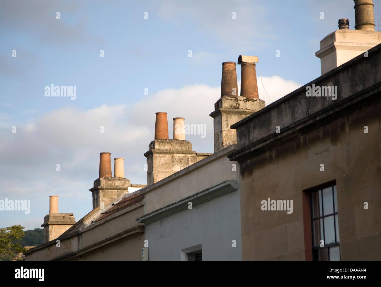 Chimney pots on house roofs Larkhall Bath England - Stock Image