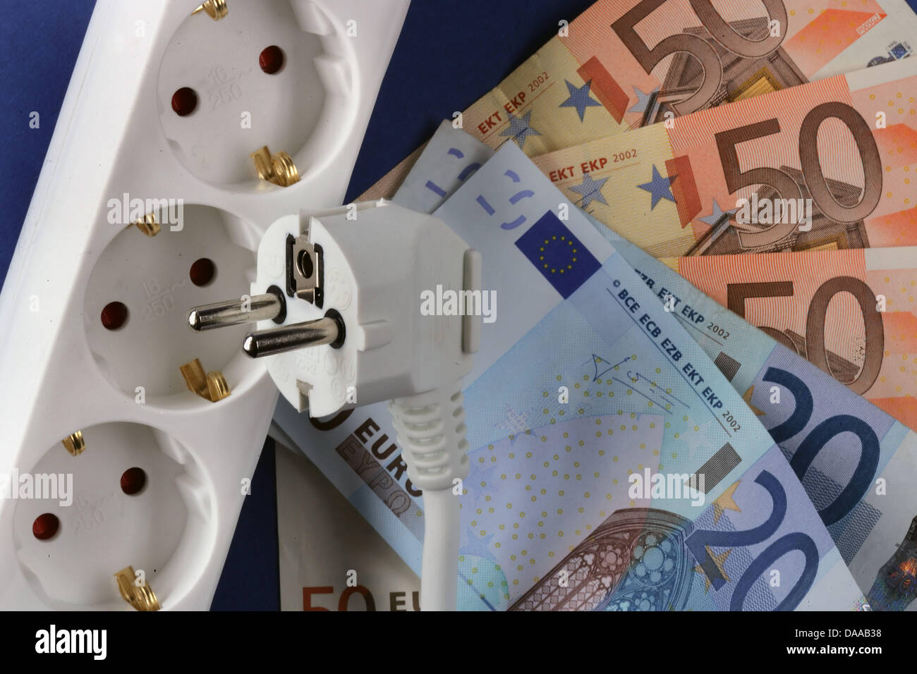 A file picture taken on 4 October 2006 shows a plug and electrical outlet next to Euro banknotes in Schwerin, Germany. - Stock Image