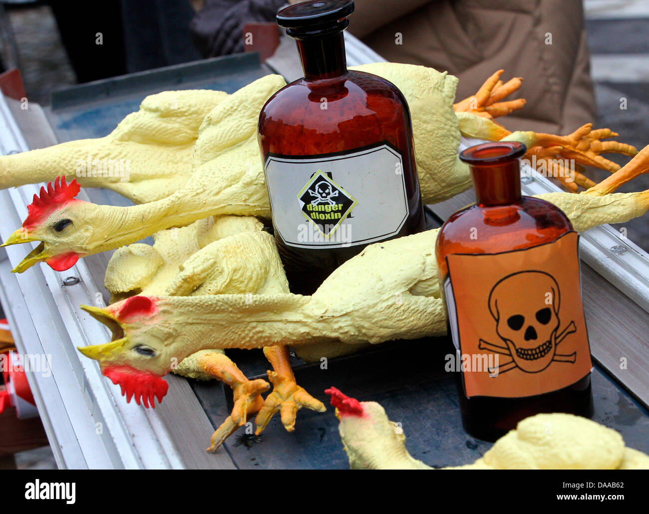 Rubber chickens and bottles with poisonous material are presented by environmental organisation Campact to protest Stock Photo