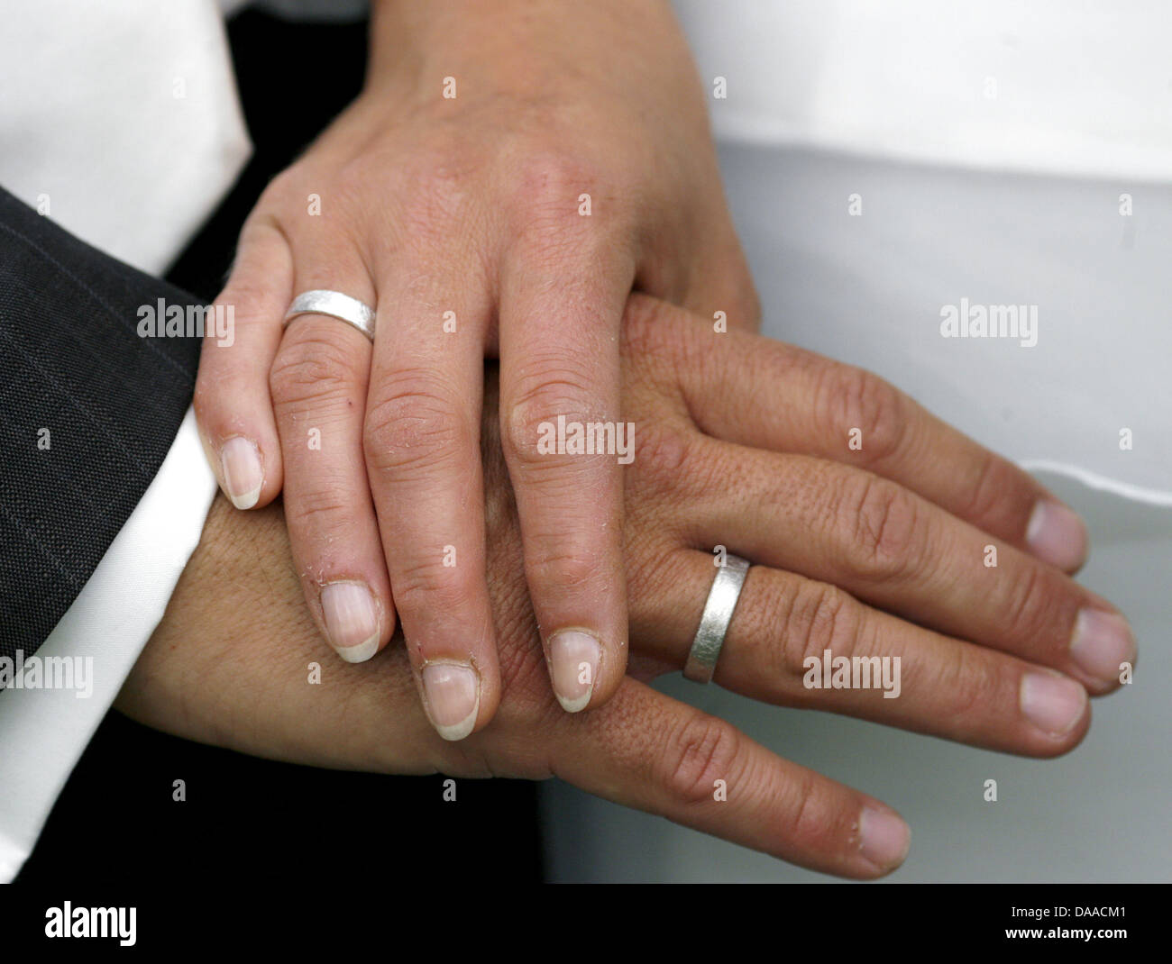 A file picture dated 19 July 2008 shows the hands with rings of a newly wed couple at the castle in Wanzleben, Germany. - Stock Image