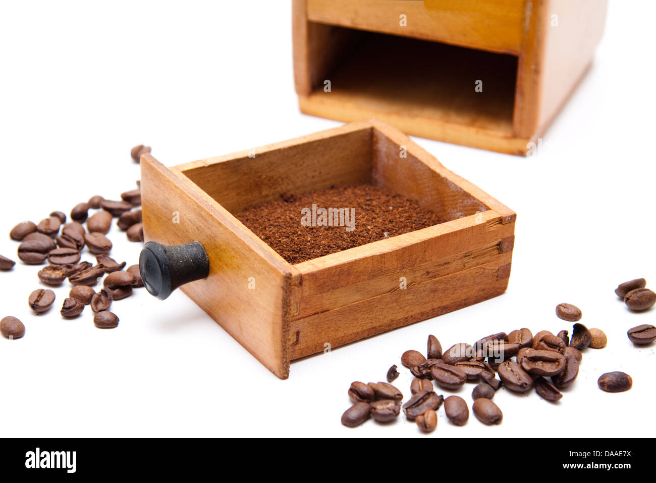 Old coffee mill with coffee beans - Stock Image