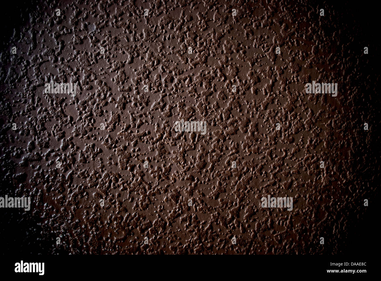 Grunge brown grained wall background or texture - Stock Image
