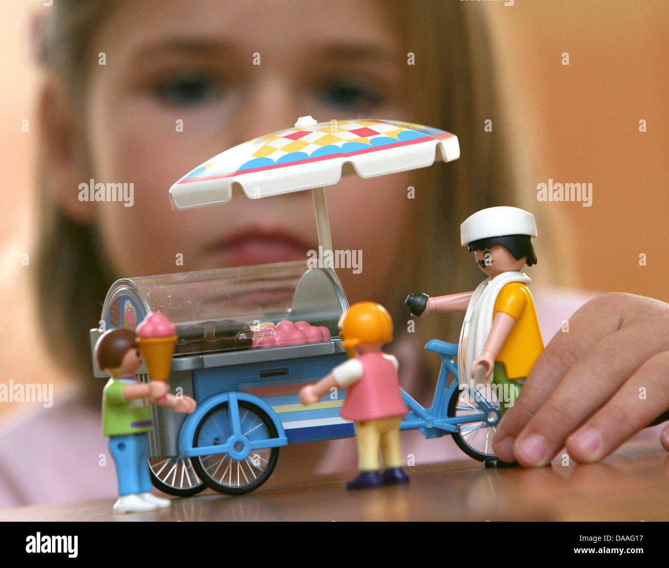 A file picture taken on 10 November 2006 shows Lea (4) who plays with an ice cream van and figures by Playmobil - Stock Image