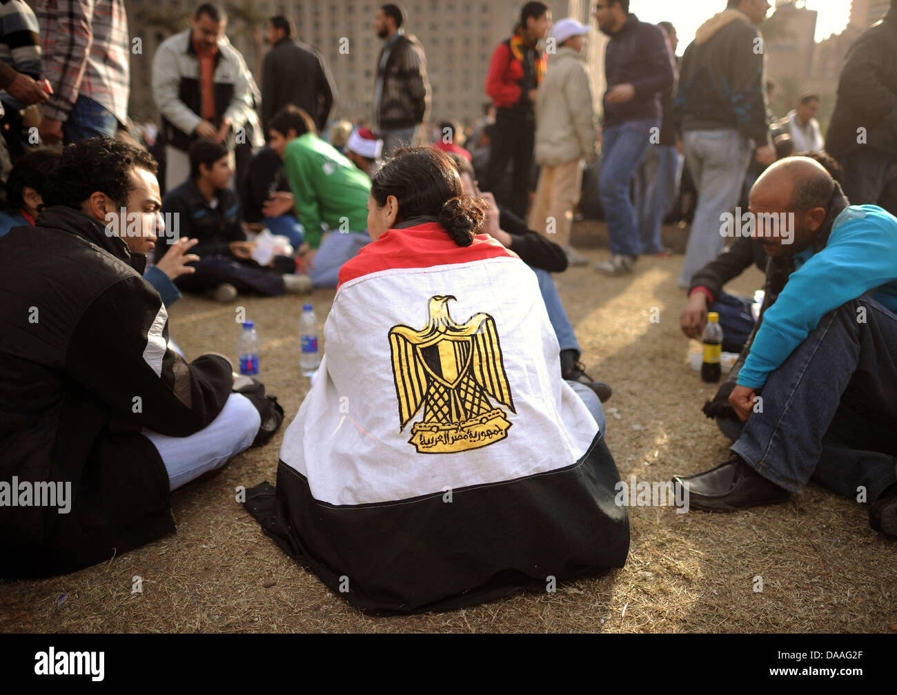 A demonstrator has wound the Egyptian flag around his shoulders at the Tharir Square in Cairo, Egypt, 31 January - Stock Image