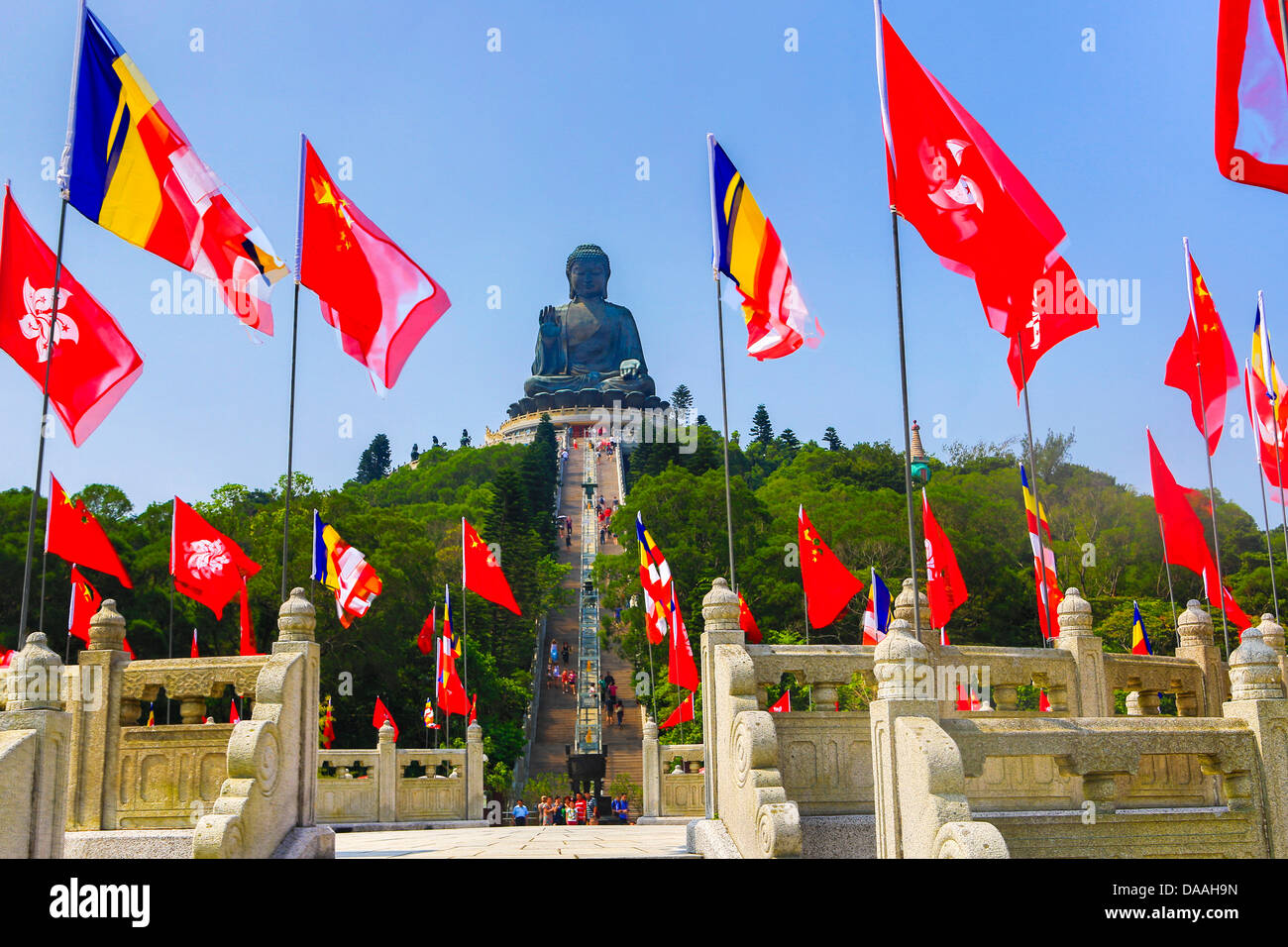 Hong Kong, China, Asia, City, Lantau, Giant Tian Tan, biggest, Buddha, colourful, faith, flags, hill, red, religion, - Stock Image