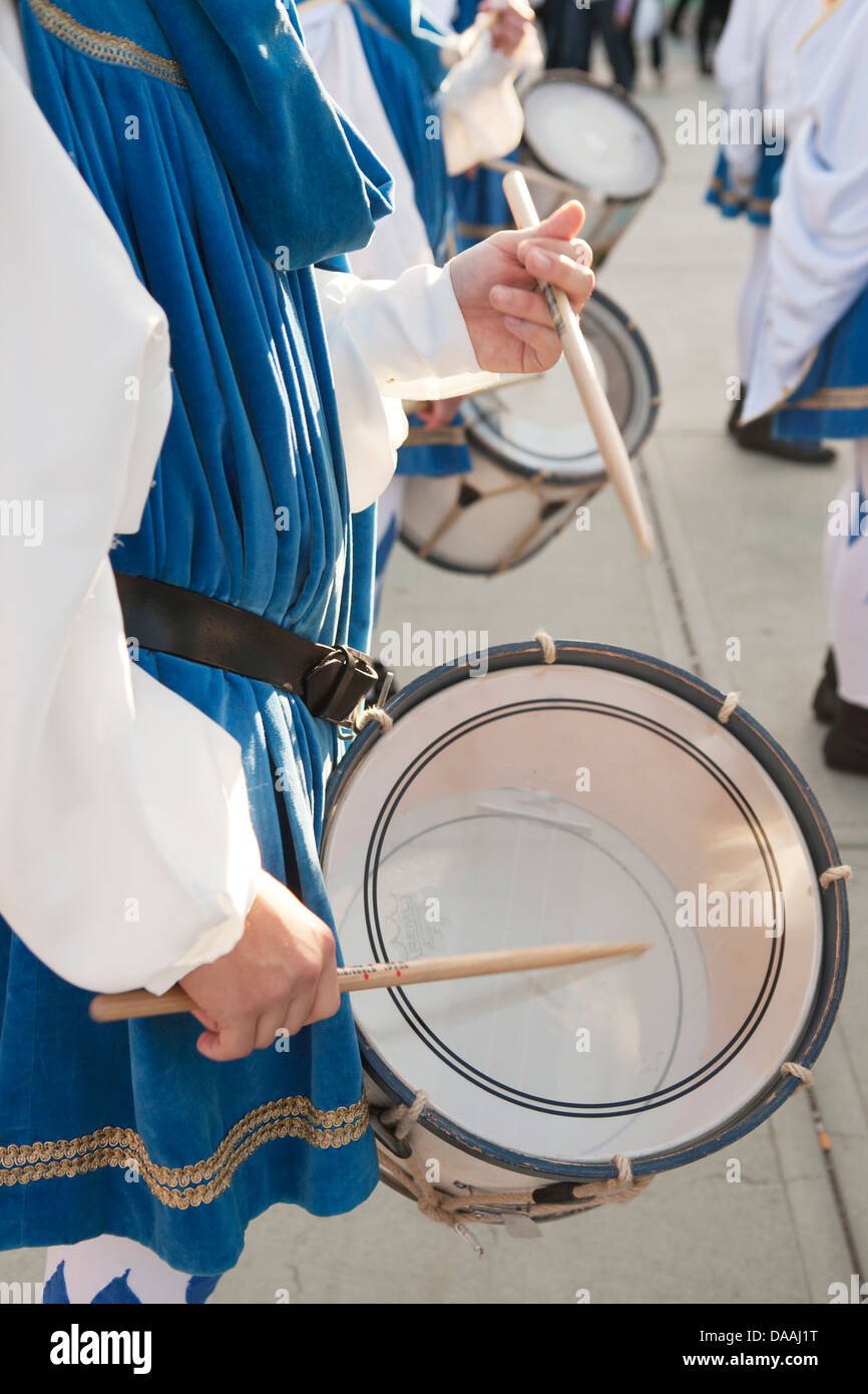 Playing the drum in the parade - Stock Image