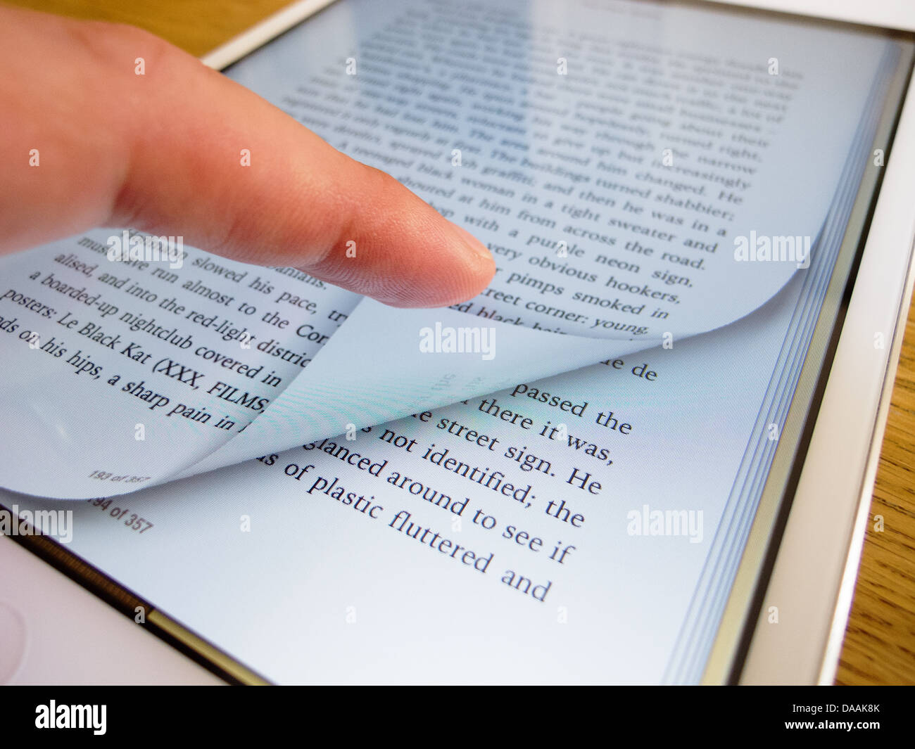 Detail of iPad mini screen showing iBooks ebook reader with page turning - Stock Image
