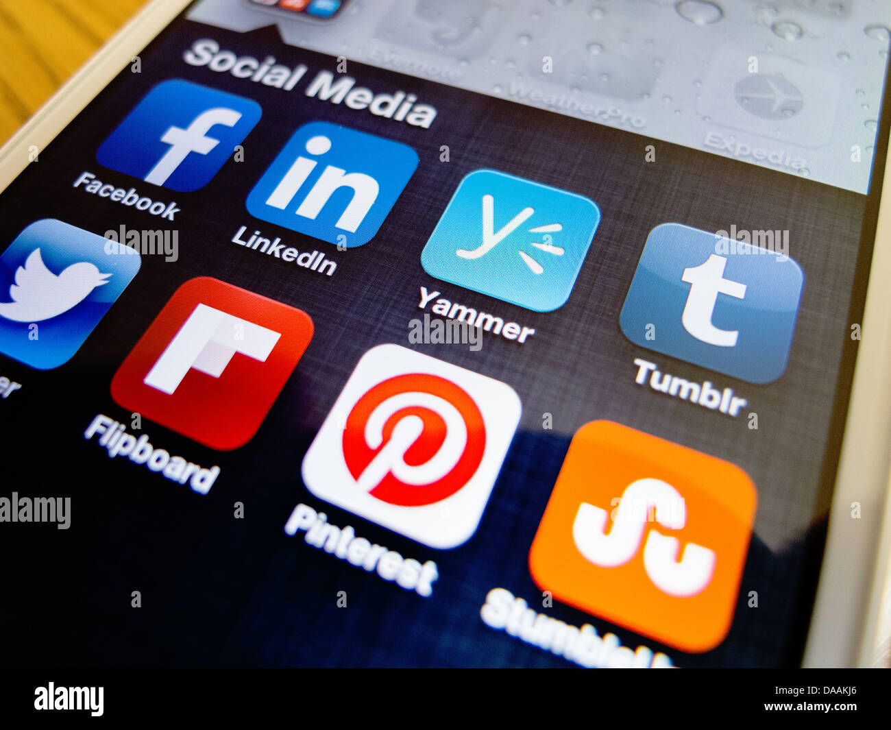 Detail of iPhone 5 smart phone screen showing social media apps icons - Stock Image