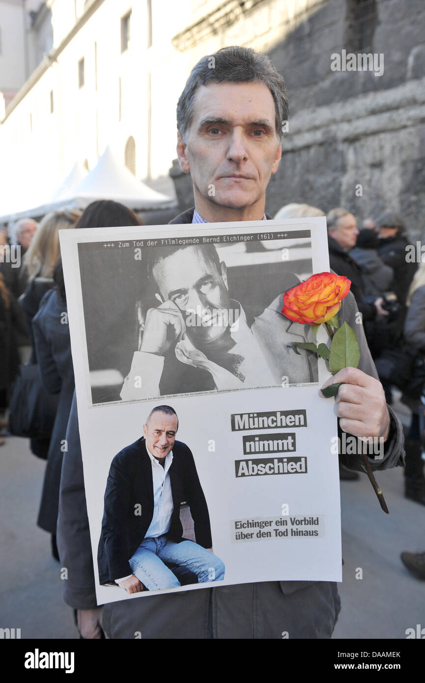 Fan manfred weiers holds a poster with goodbye greetings as the fan manfred weiers holds a poster with goodbye greetings as the mourning ceremony for german director bernd eichinger at st michaels church takes place in m4hsunfo