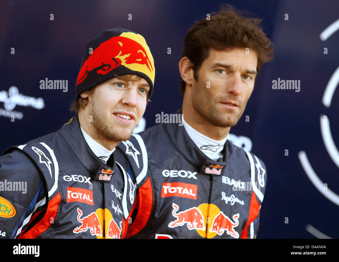 4bd0b401134 Australian Formula One driver Mark Webber (R) of Red Bull Racing and his  German compatriot Sebastain Vettel (L) smile during test drives in  Valencia
