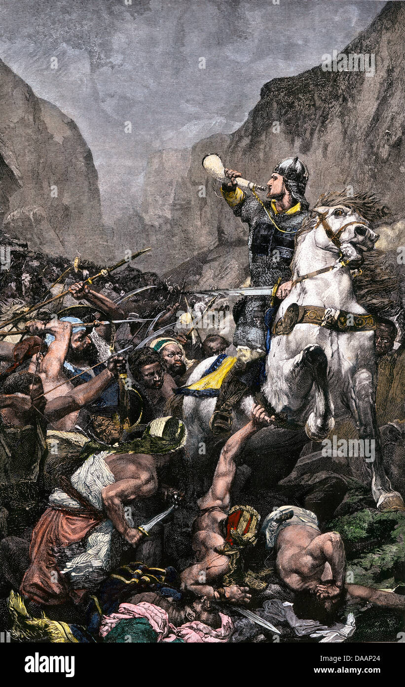 Roland blowing his warhorn in battle against the Saracens at Roncesvalle, 789 AD. Hand-colored woodcut - Stock Image