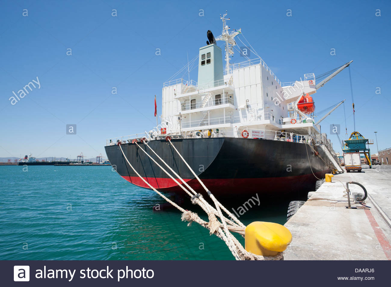 Bulk tanker moored at commercial dock - Stock Image