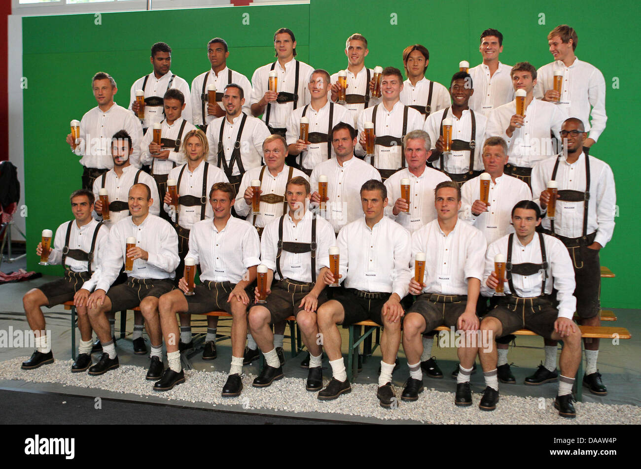 The FC Bayern Munich soccer team wears lederhosen and hold beer mugs during  a sponsorship appointment in Munich 949ac0ba8