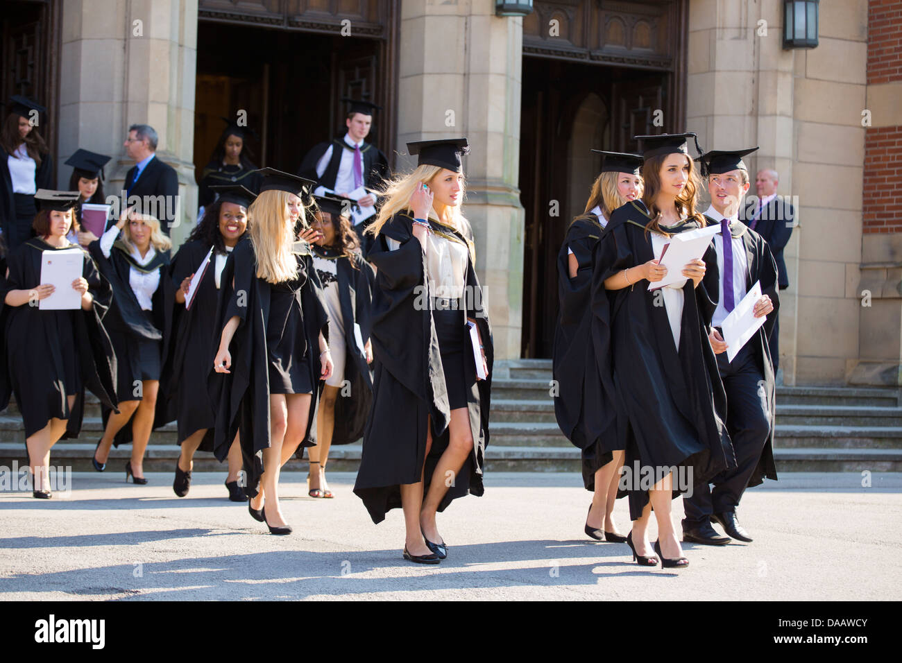 Graduates leaving the Great Hall at Birmingham University, UK, after the graduation ceremony - Stock Image
