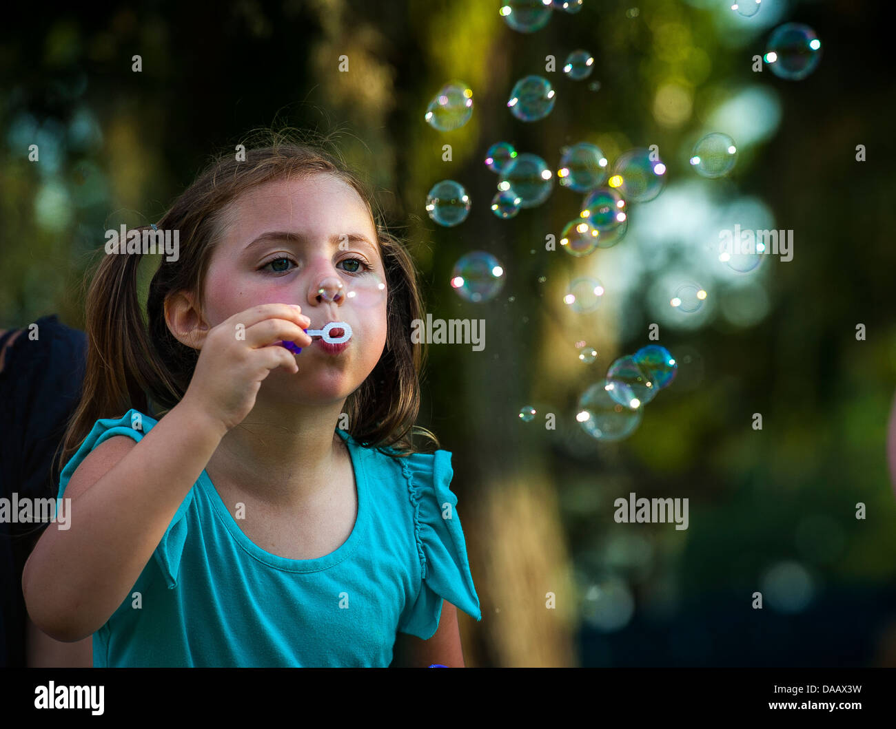Jenna Calafiore, daughter of Jeff Calafiore, Zero to Never band member, blows bubbles, during the 2013 Freedom Fest - Stock Image