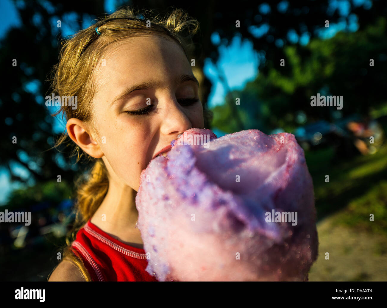 A military dependent eats cotton candy June 28 during the 2013 Freedom Fest at Marrington Plantation at Joint Base - Stock Image