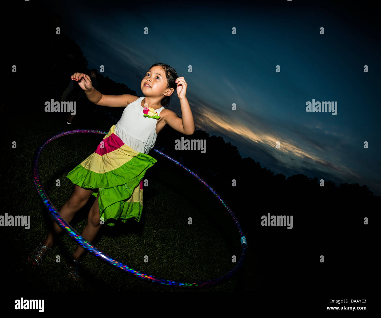 A military dependent hula hoops June 28 during the 2013 Freedom Fest at Marrington Plantation at Joint Base Charleston - Stock Image