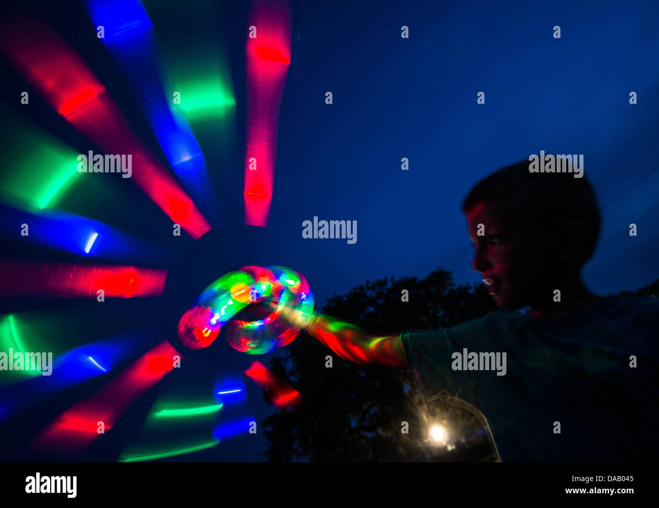 A military dependent twirls a light stick June 28 during the 2013 Freedom Fest at Marrington Plantation at Joint - Stock Image
