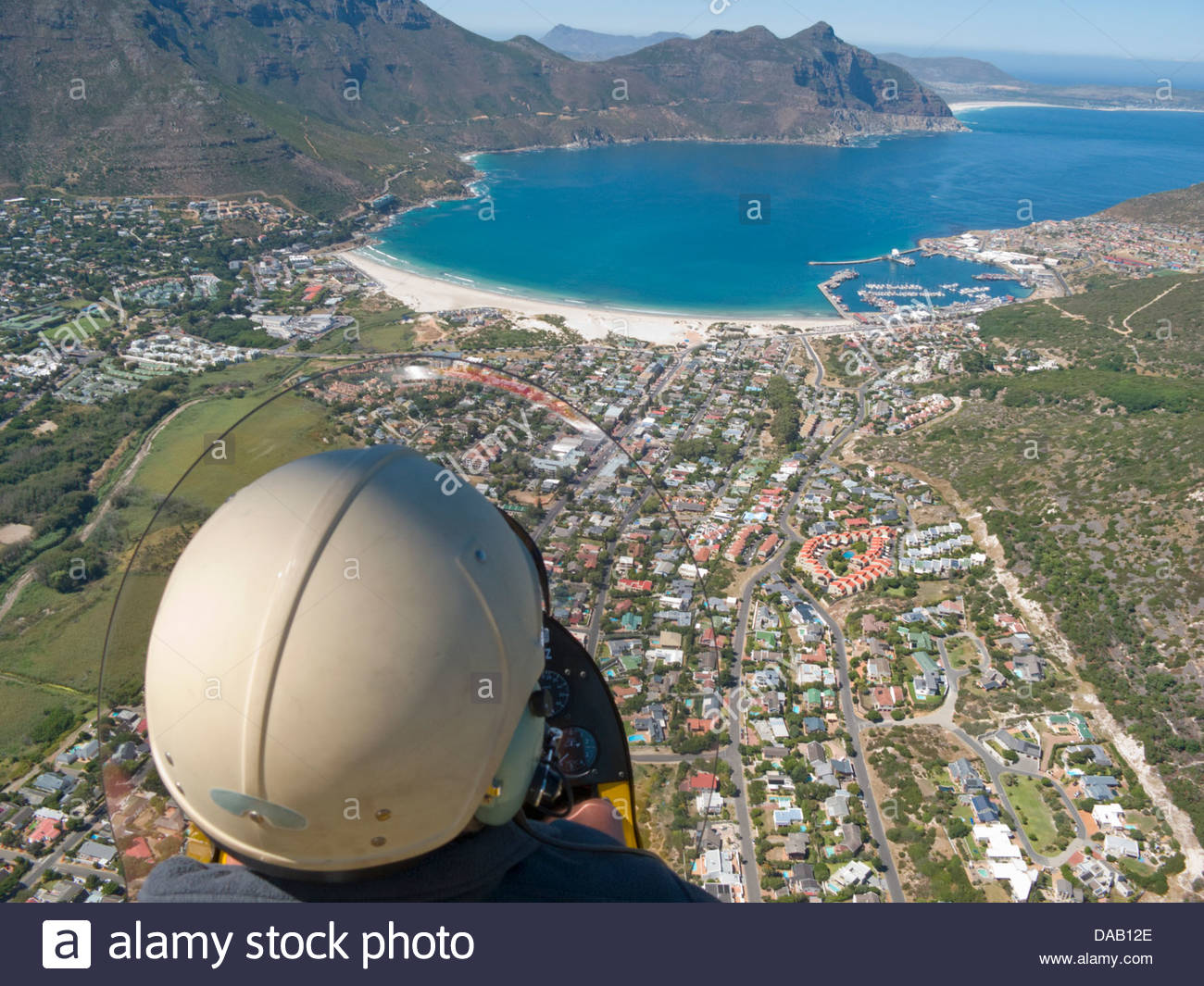 Man flying over Hout Bay, Cape Town, South Africa - Stock Image