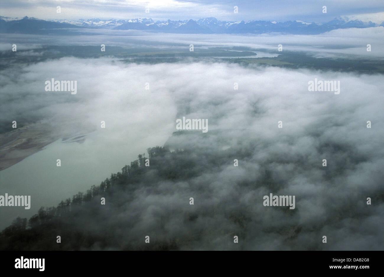 Coastal Plain, Cook Inlet, Chigmit Mountains, Aleutian Range, Alaska, USA, fog, clouds, above clouds, lush forest, - Stock Image