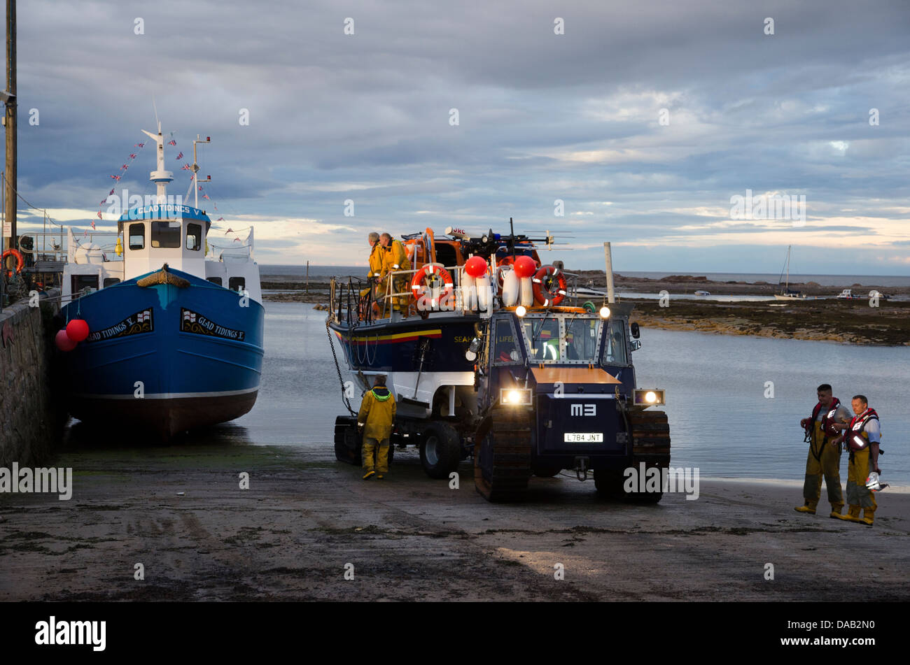 RNLI lifeboat grace darling recovered by tractor from sea following practice operation seahouses harbour northumberland - Stock Image