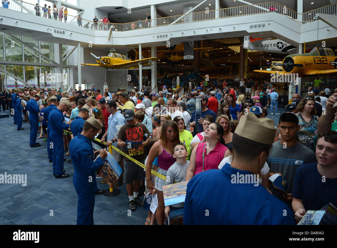 Team members of the U.S. Navy flight demonstration squadron, the Blue Angels, sign autographs at the National Naval - Stock Image