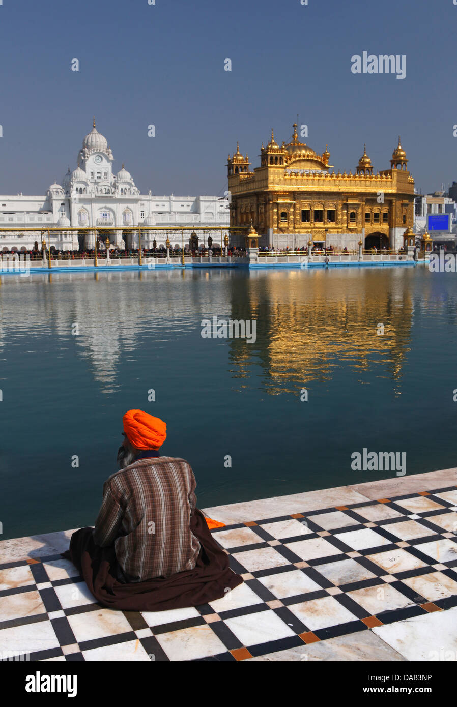 More golden, temples, Amritsar, sanctum, pray, religion, faith, sari, turban, lake, washbasin, holy, meditation, - Stock Image