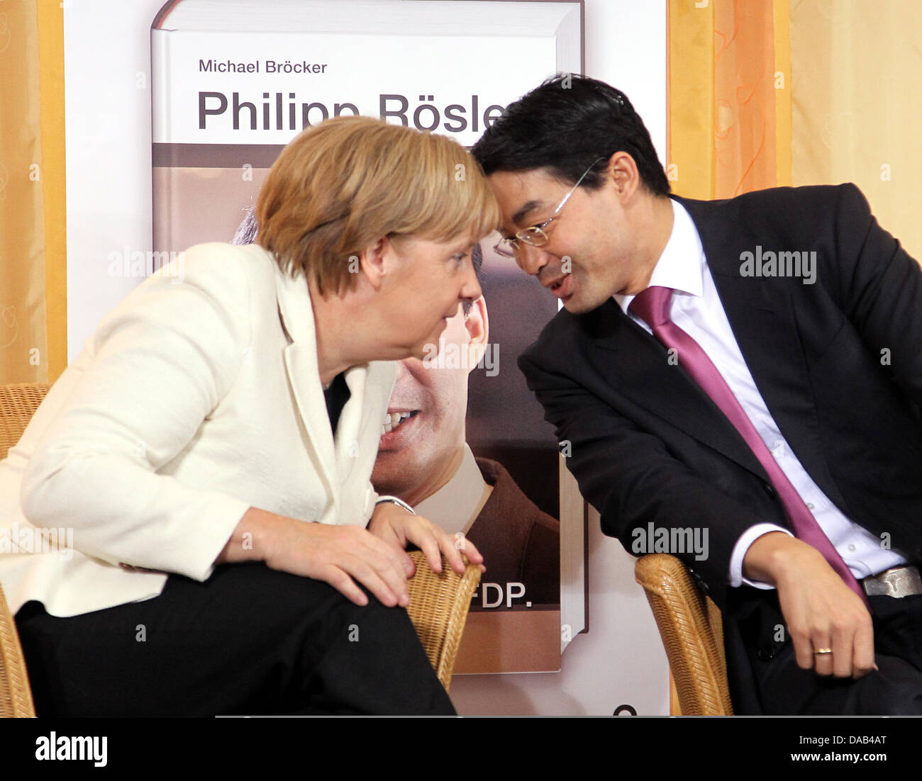 Chancellor Angela Merkel And Vice Chancellor Philipp Roesler Present Stock Photo Alamy