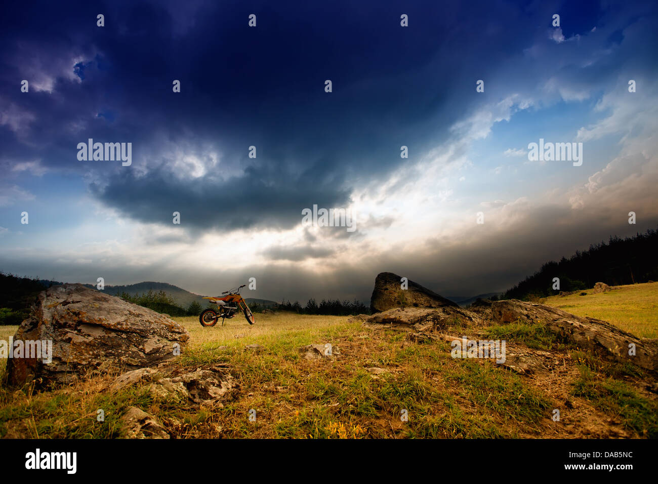 scenic HDR sunset with dirt bike - Stock Image