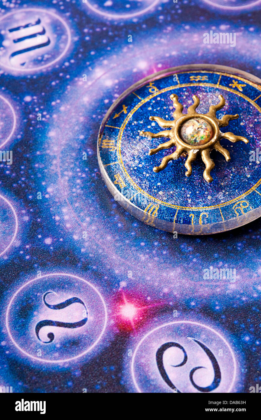 astrology wheel and zodiac charm - Stock Image