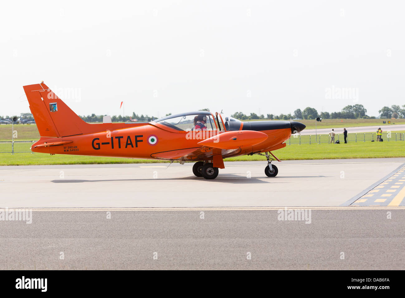 Privately owned SIAI-Marchetti SF-260AM on the runway at RAF Waddington Airshow 2013 - Stock Image