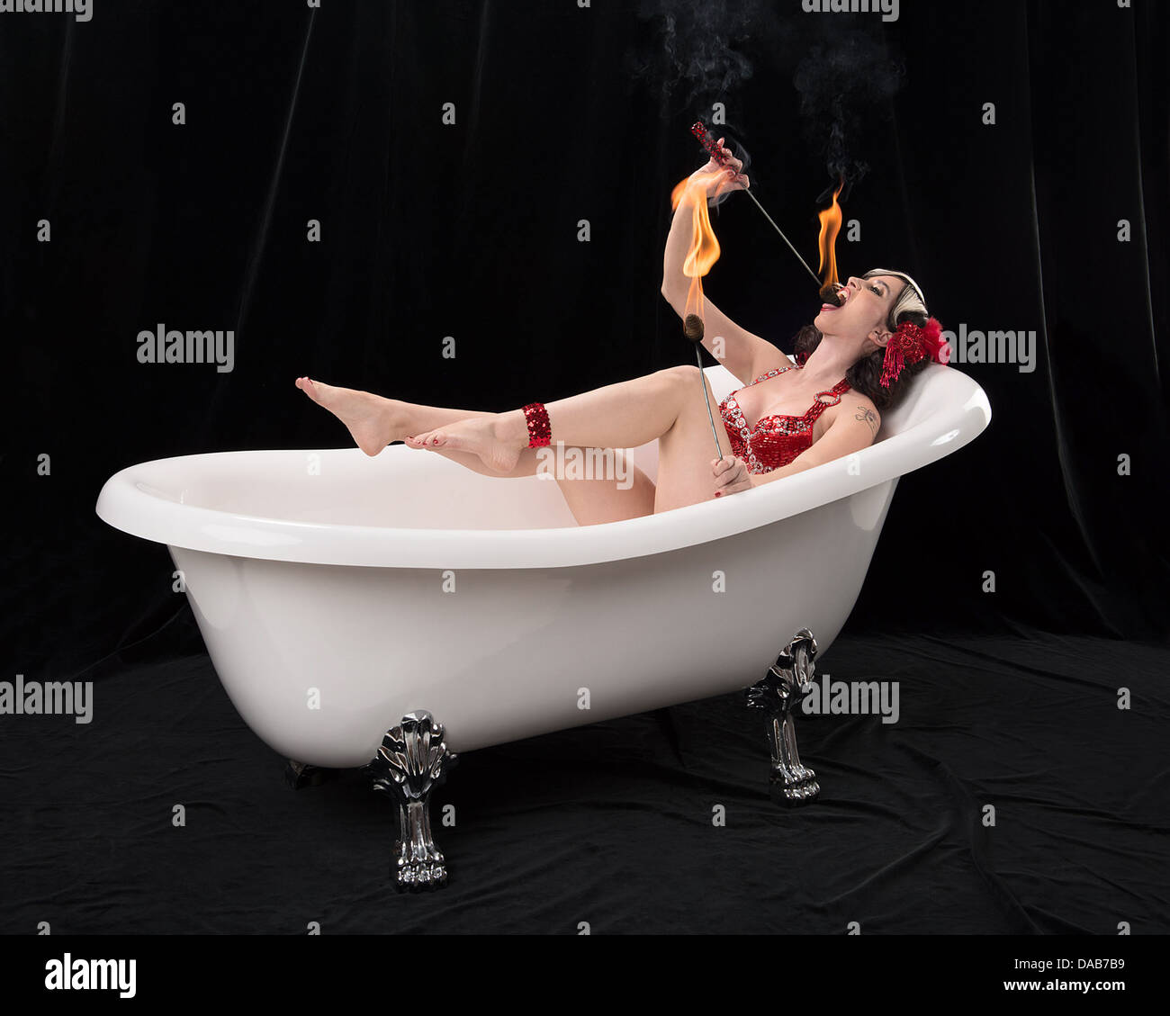 Fire-eating woman in a Victoria + Albert claw foot tub in Virginia ...