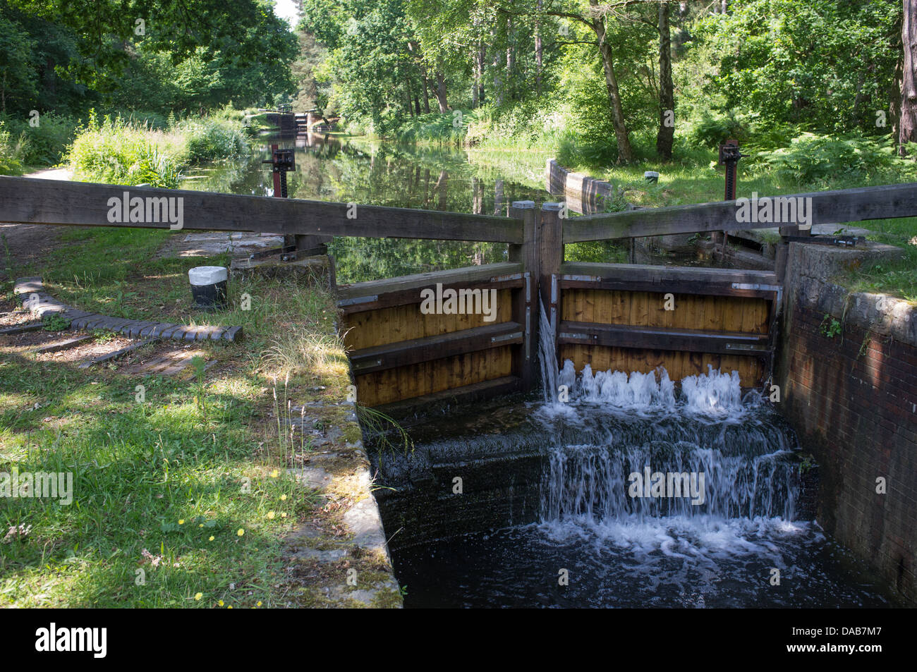 Lock on The Basingstoke Canal with Leaking Lock Gates -5 - Stock Image