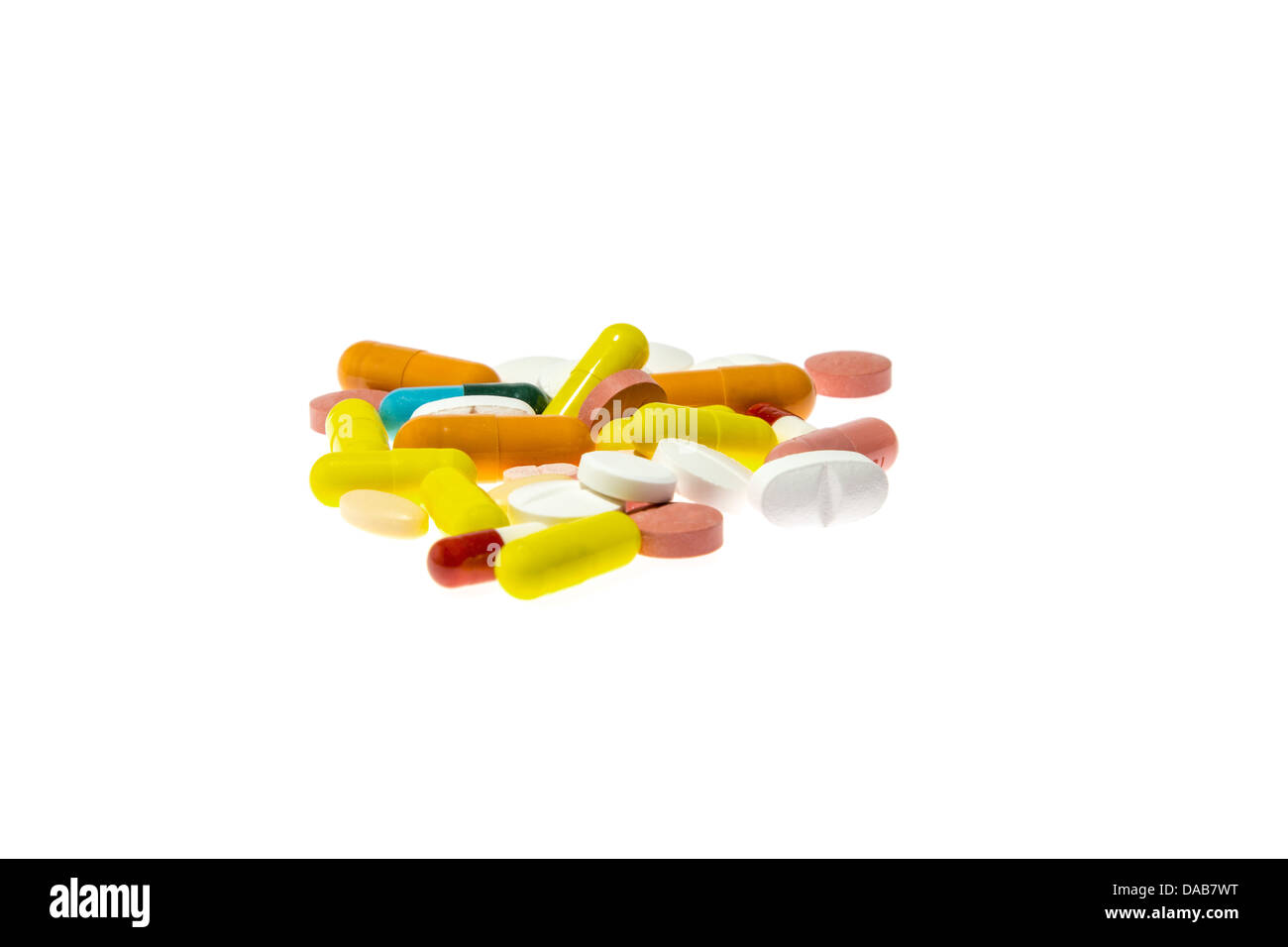 Pills of different colors on a table - Stock Image