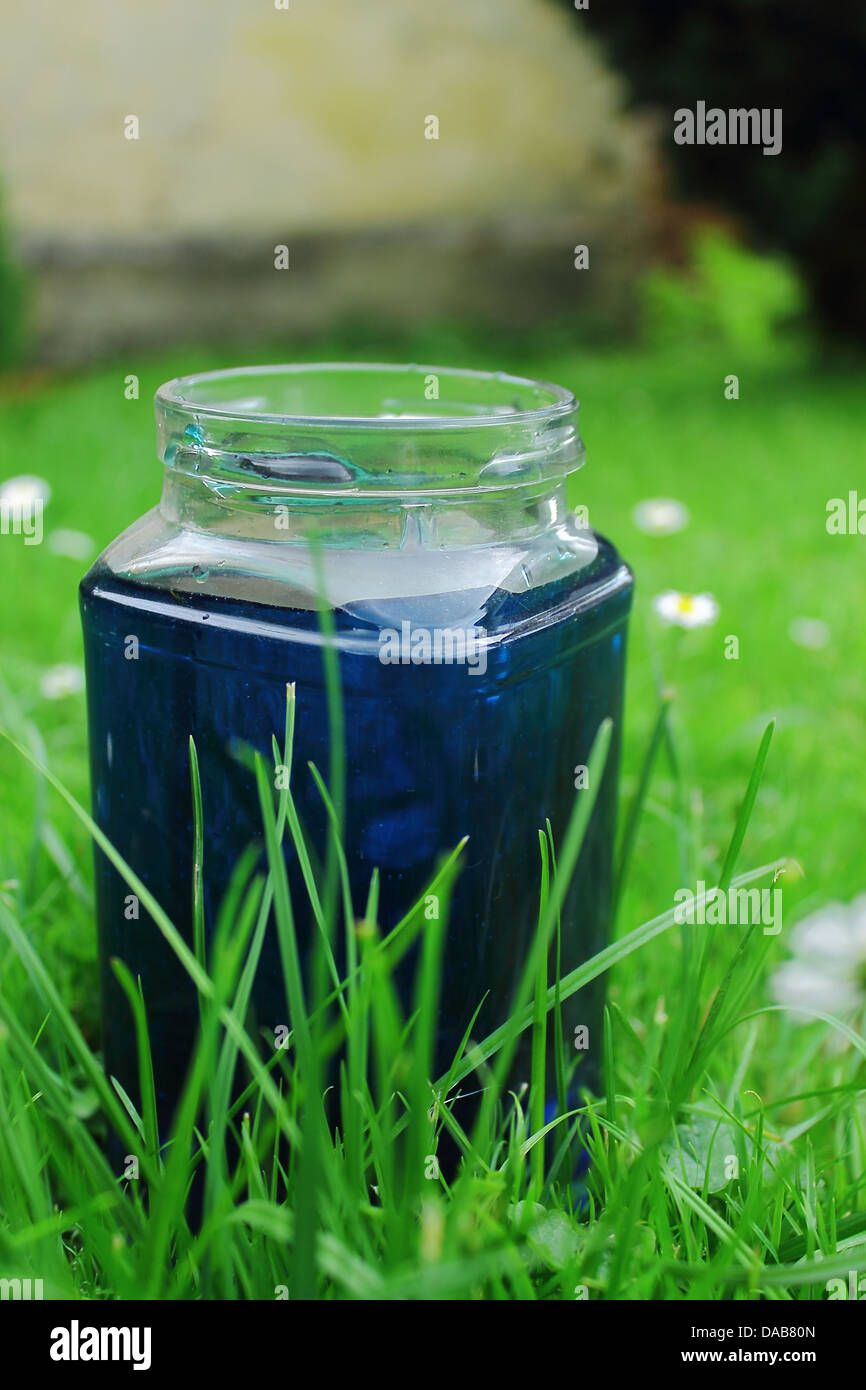 Blue water in the bottle - Stock Image