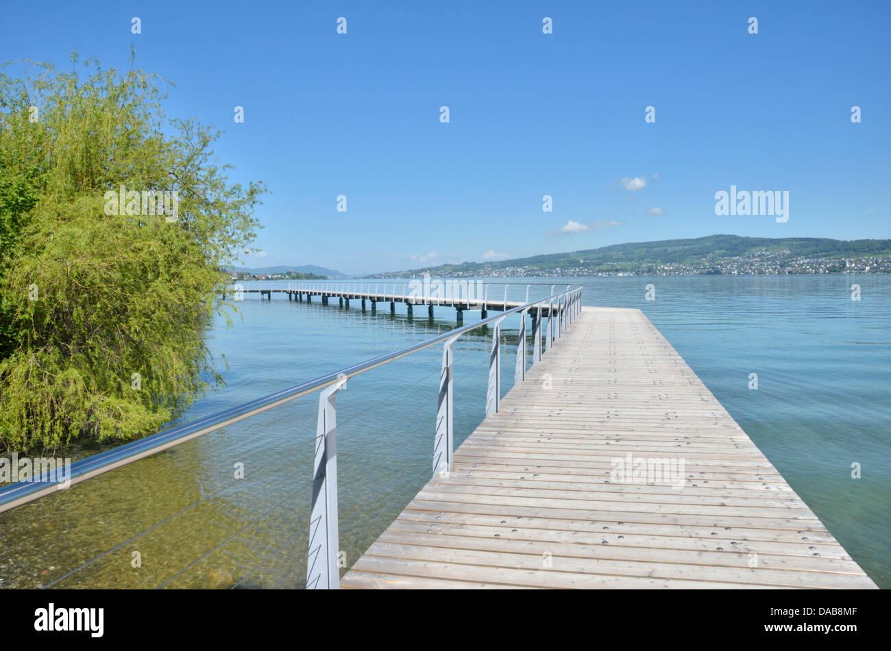Wooden causeway on Lake Zurich near Wädenswil, Switzerland - Stock Image