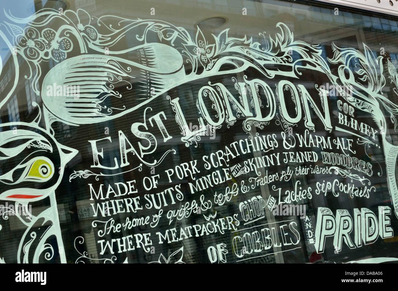 An inscription celebrating East London on a shop window, London, UK - Stock Image